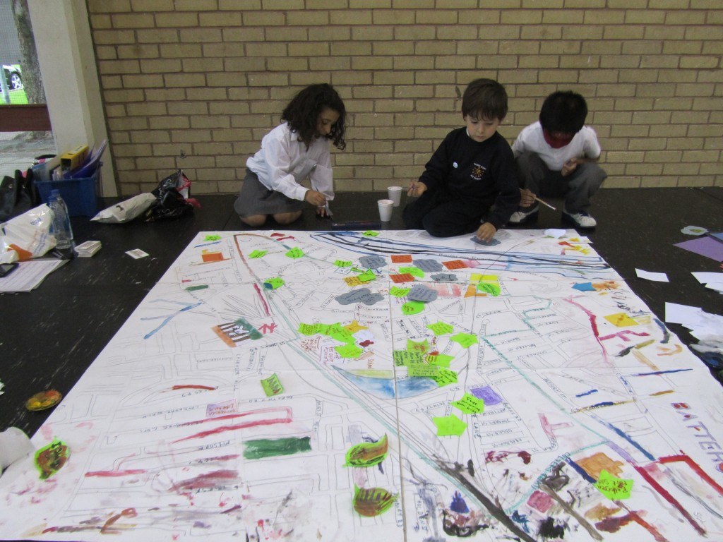 The children drawing their ideas on the map of Big Local SW11